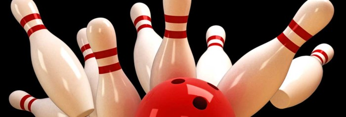 bowling pins being hit by ball